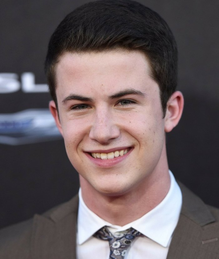 classical male hairstyle, worn by dylan minette, dark brown hair, short guy haircuts, he's wearing a suit and tie