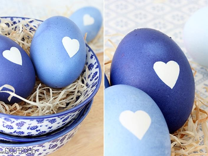 heart shapes in white, on eggs painted in different shades of blue, how to dye easter eggs, faux straw and patterned ceramic bowls