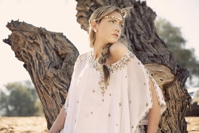 braided blond hair, on woman with beaded headband, bohemian style clothing, wearing floaty white off-shoulder blouse, with embroidery and beads