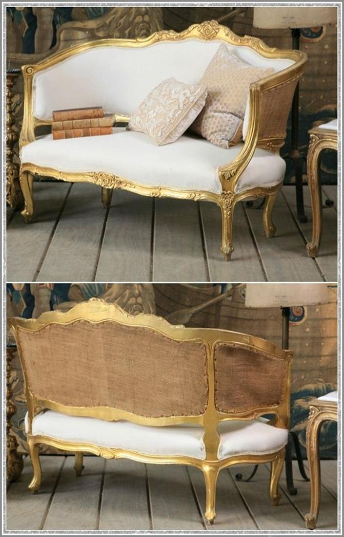 golden legs and armrests, on white french sofa, with rough beige back, shabby chic aesthetic , cushions and vintage books