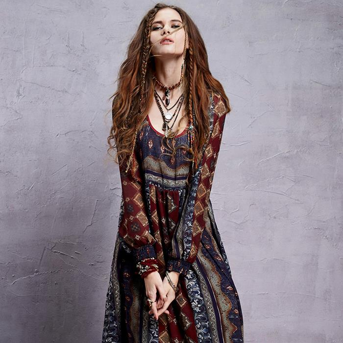 boho chic maxi dess, in burgundy and navy, with grey and brown indian print, worn with several oriental pendants, by brunette woman with long hair, and two small braids