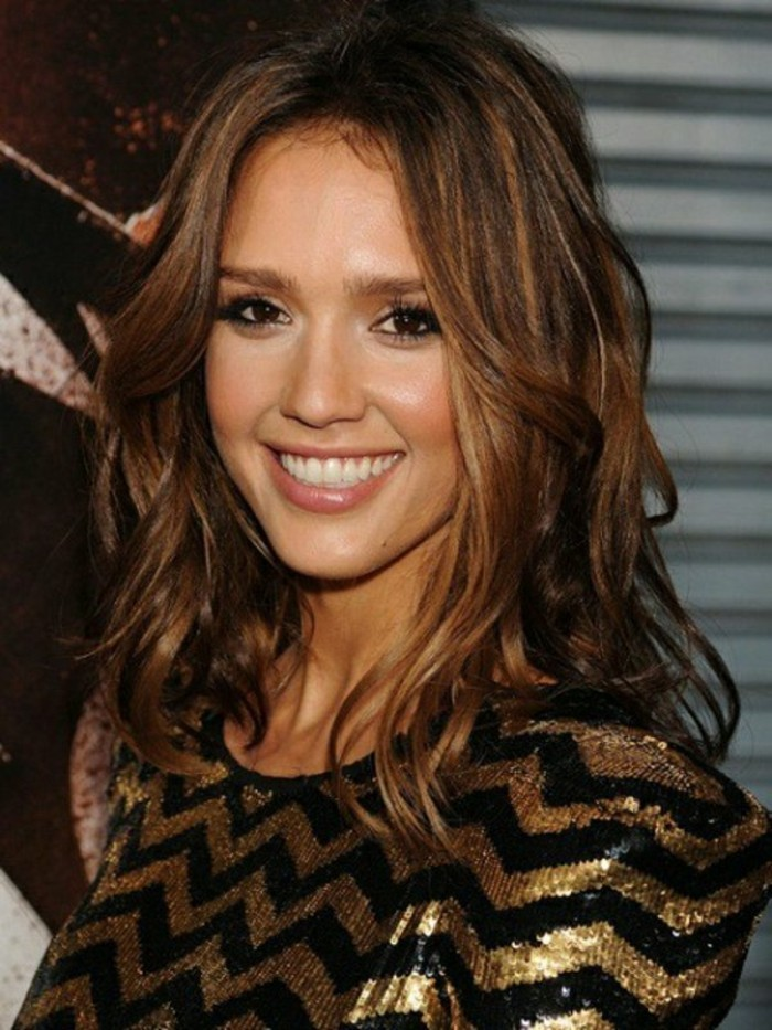 sequin top in black and gold, worn by smiling jessica alba, with wavy brown hair, and honey-blonde highlights, dark haired actresses, black mascara and nude lipstick