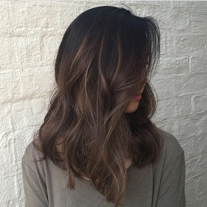 khaki top with long sleeves, worn by woman with wavy hair, and discreet highlights, brunette hair colors