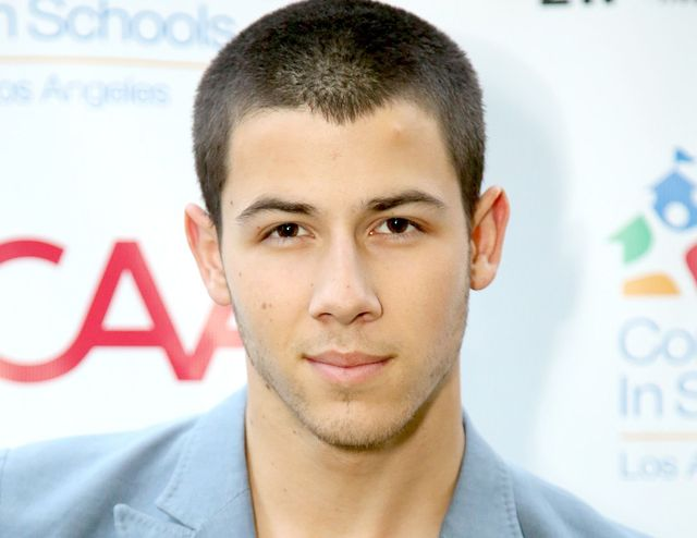 buzz cut in military style, on nick jonas, short guy haircuts, dark brown hair, pale blue blazer