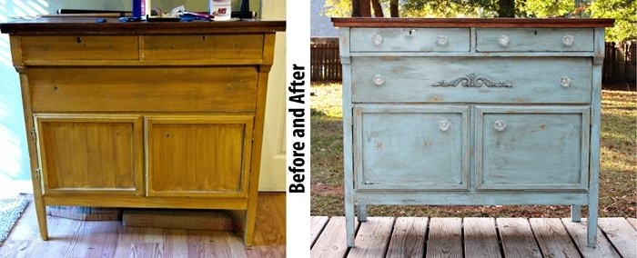 old country house cupboard, decorated with ornaments, and unevenly repainted in pale teal, and dark brown