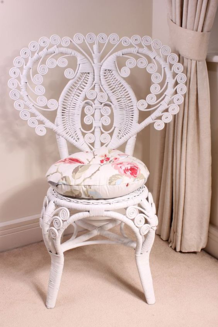 chair in white with ornamental, heart-shaped backrest, and floral cushion, shabby sheek look, beige carpet and curtains