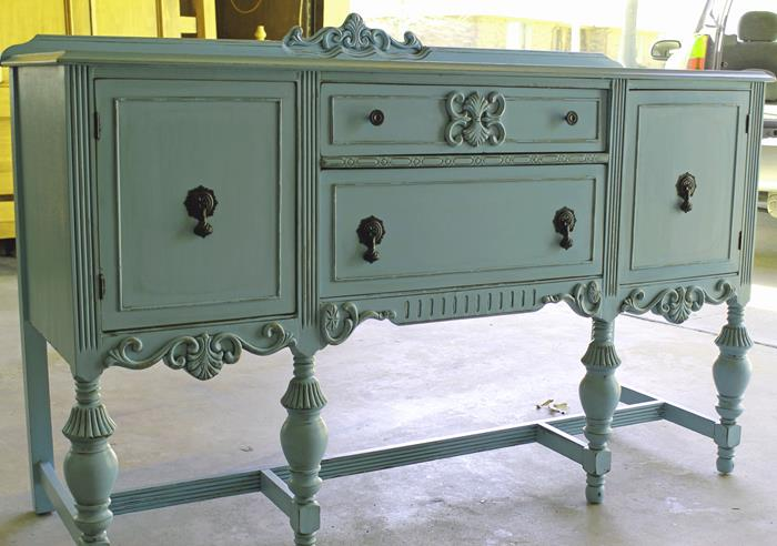 pastel turquoise antique cupboard, with ornaments and black handles, country cottage furniture