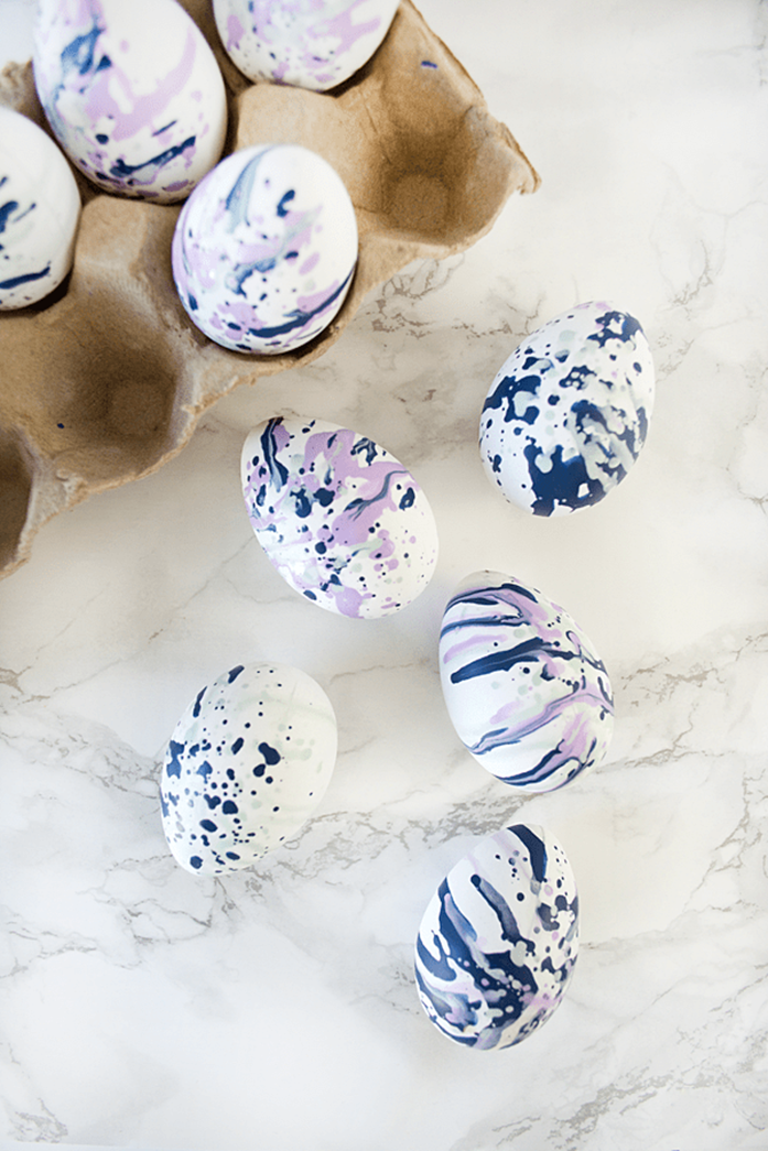 nine white eggs, decorated with runny blue and pink paint, using a straw, clever easter idea