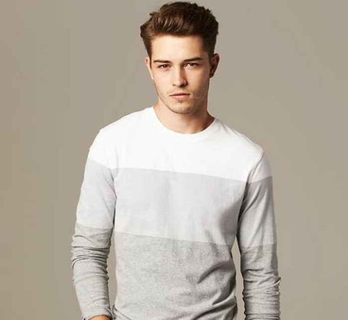 boys short haircuts, dark auburn hair, styled in a modern pompadour, and worn by young man, in grey jumper