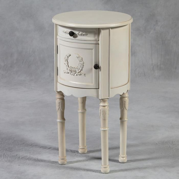 off-white decorative round antique cupboard, with small black round handles, country chic décor, on pale grey background