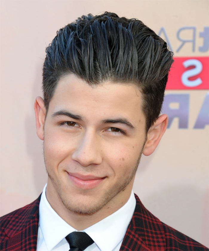 smooth black hair, with long bangs slicked back, guys haircuts, on nick jonas, wearing a red plaid blazer, white shirt and black tie