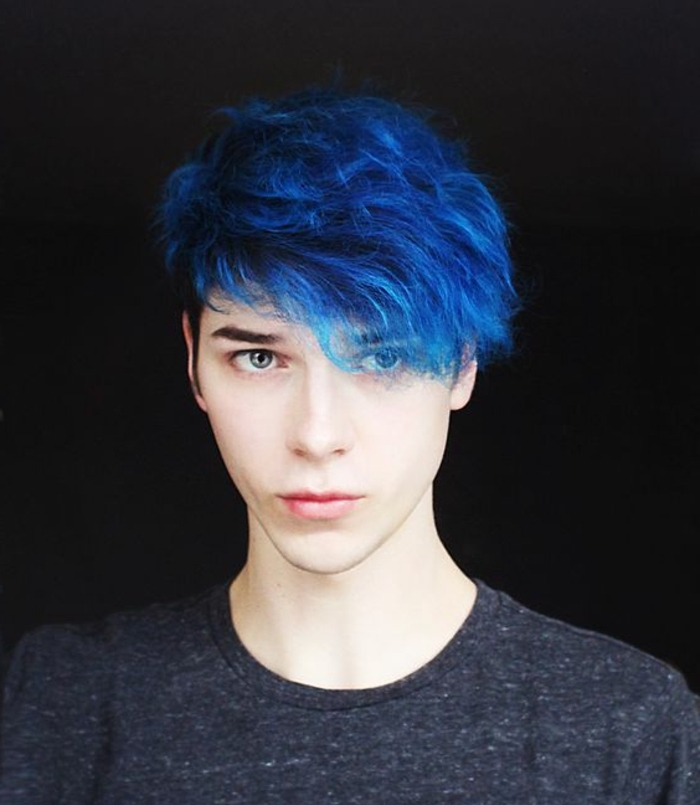 blue curly hair, with long bangs falling over one eye, long hairstyles for boys, on teenager in dark grey t-shirt