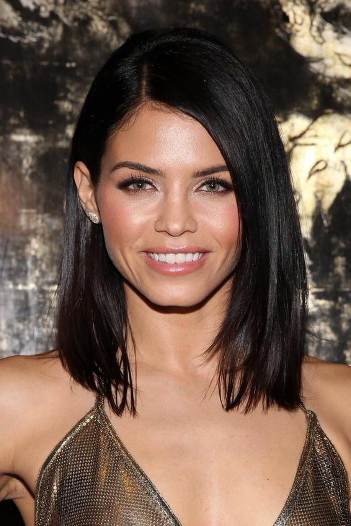 golden sparkly strappy dress, worn by smiling woman, with blush and pale pink lipstick, very dark brown hair, brunette hairstyles, smooth and straight with a side parting