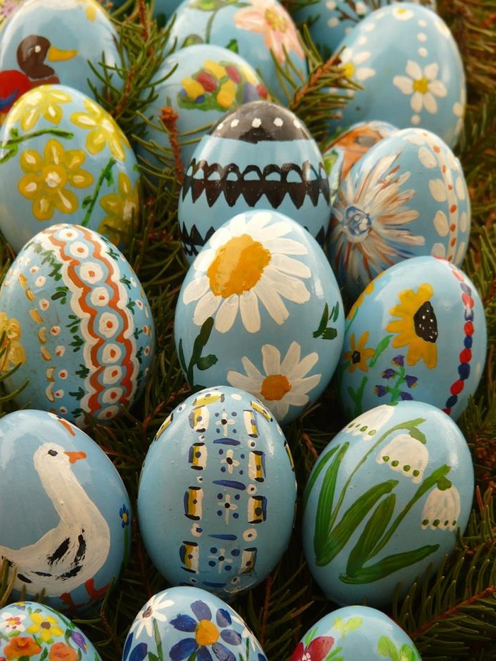 glossy blue hen's eggs, decorated with hand-painted daisies, snow drops and sunflowers, ducks and storks, easter egg ideas