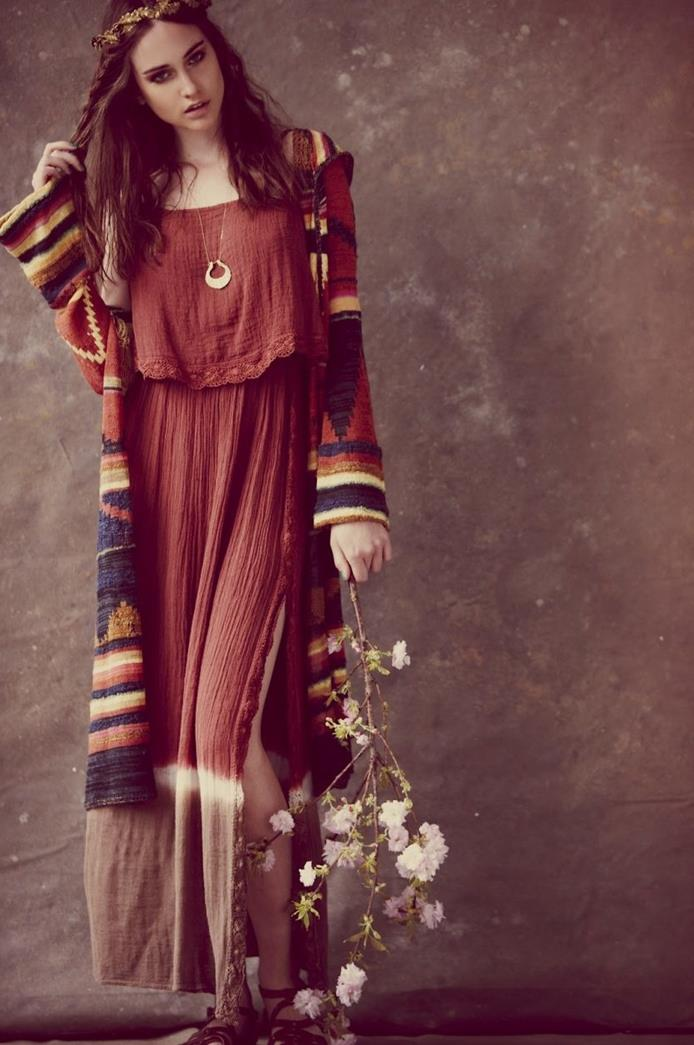 dip-dyed red dress, with brown hem and side slit, worn with multicolored, ethnic print oversized cardigan, by brunette woman, holding a blossoming tree branch