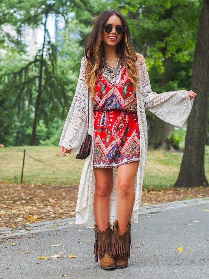 red mini dress, with colorful indian paisley pattern, worn with oversized, pale cream cardigan, tasseled brown calf boots, sunglasses and small bag, bohemian style clothing