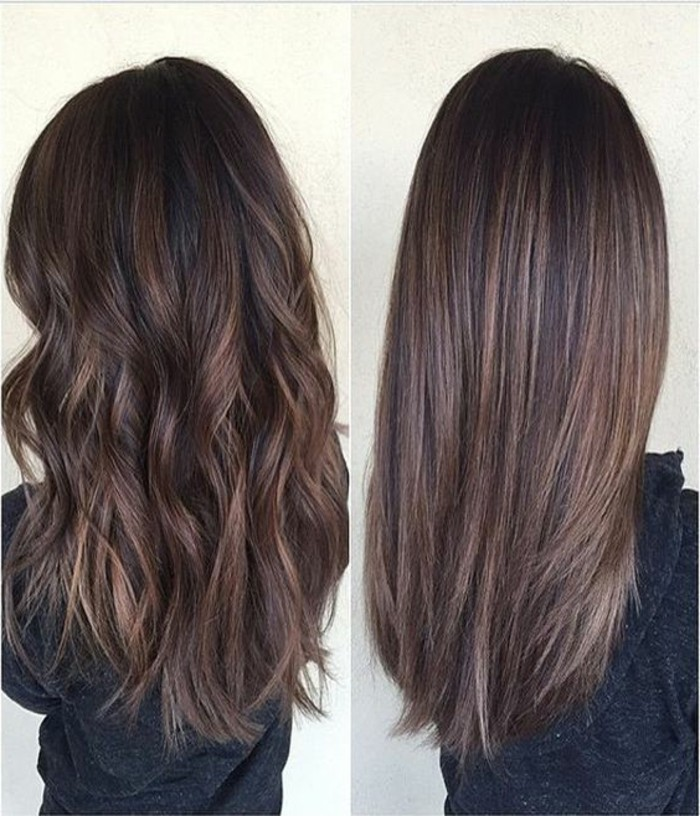 medium brown hair color, images showing two versions of the same long, brunette hair, one is curly and one is straight, both are worn by woman in dark grey sweater