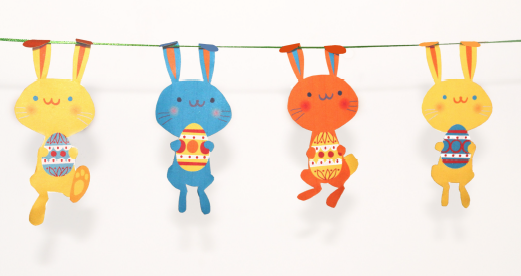 hand-crafted garland, decorated with cute yellow, orange and blue bunnies, holding painted eggs, easter crafts for adults