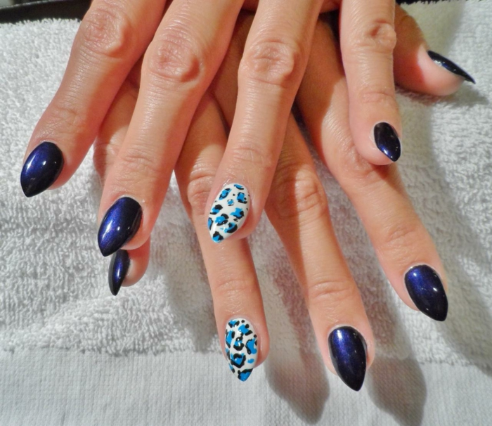 electric dark violet, and white nail polish, decorated with animal print, in light and dark blue, leopard spots style, short stiletto nails