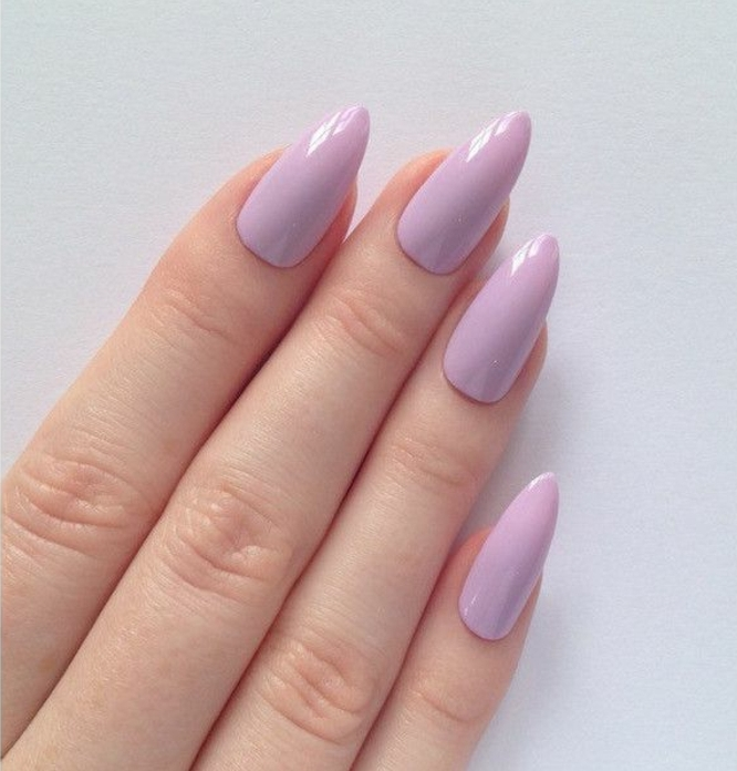 pointy nails, close up of four fingers, with sharp manicure, covered in pastel pink nail polish