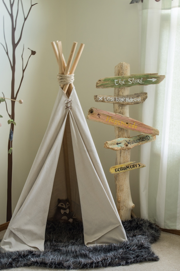 teepee or tipi, made with cream colored fabric, and wooden poles, on fluffy gray carpet, baby nursery ideas