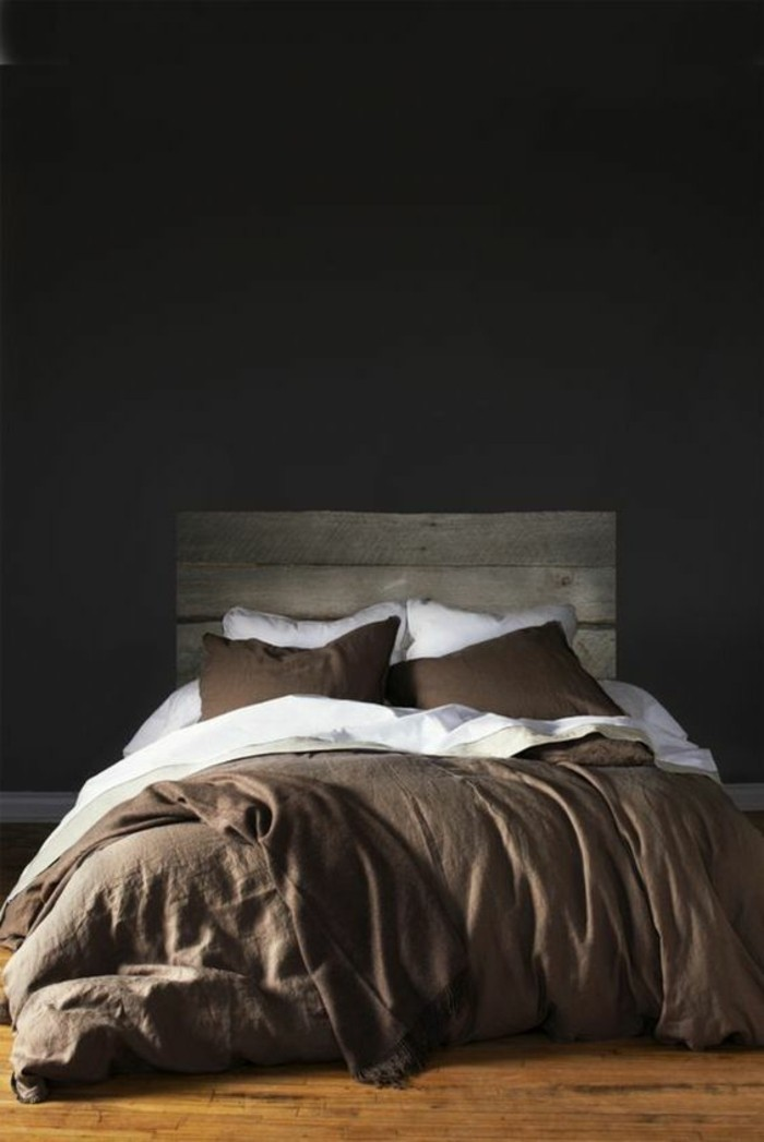 very dark gray walls, inside living room, with shabby chic bed, and wooden floors, colors that go with gray walls, brown and white bedcovers and pillows