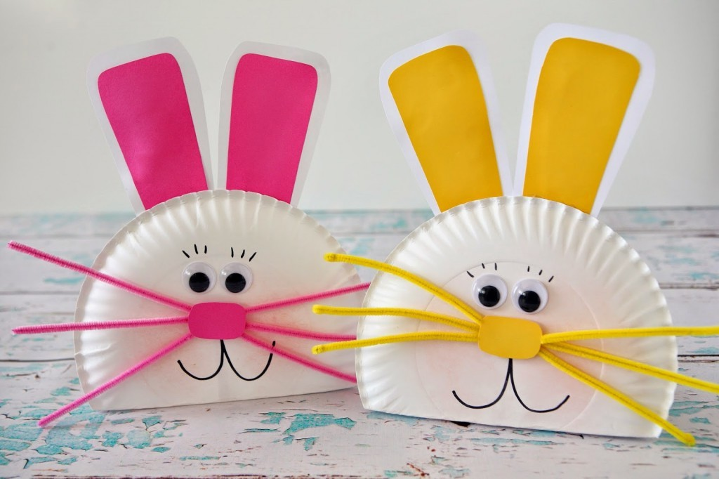 smiling easter bunny faces, made from white paper plates, decorated with hot pink and yellow, paper cutouts and fuzzy wire