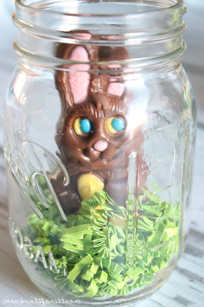 jar filled with pale green, easter grass, made out of paper, and a chocolate bunny, easter projects, easy festive idea