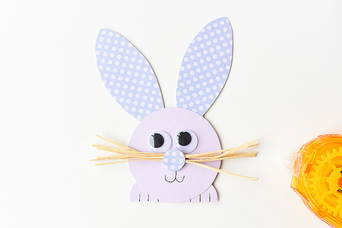 cute rabbit head and paws, made out of pale purple paper, with spotted violet ears, and straw-like whiskers, easter diy