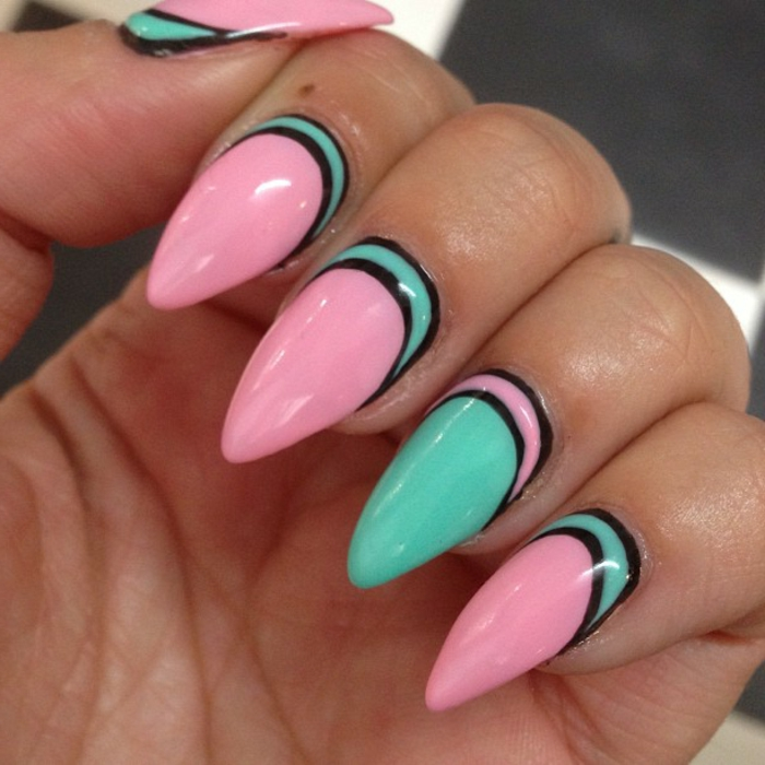 candy pink and turquoise contrasting nail polish, decorated with black lines, on sharp long manicure