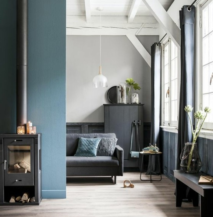 rural villa living room, white wooden beams on ceiling, blue grey paint, on one wall and paneling