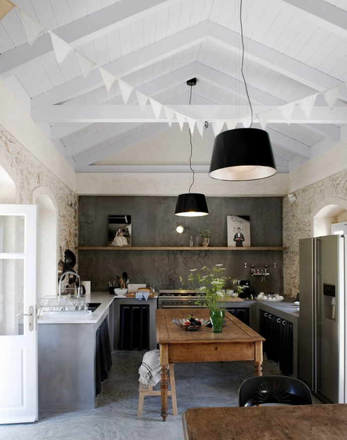 modern and rustic kitchen combination, vintage wooden kitchen island and dining table, gray wall with wooden shelf, white vaulted ceiling
