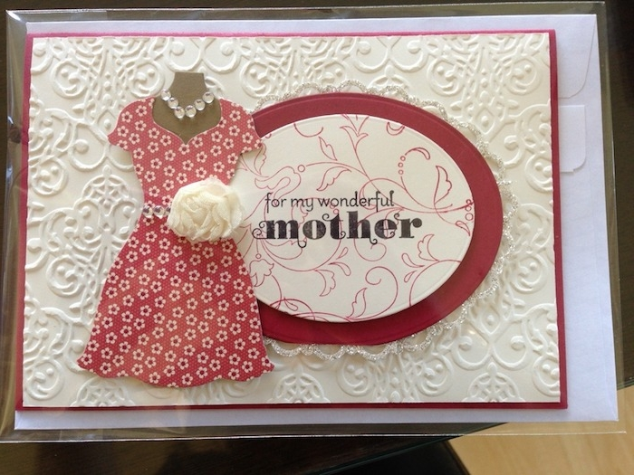 embossed off-white card, decorated with paper cutouts, last minute mother's day gift ideas, red and white floral dress, necklace and white flower