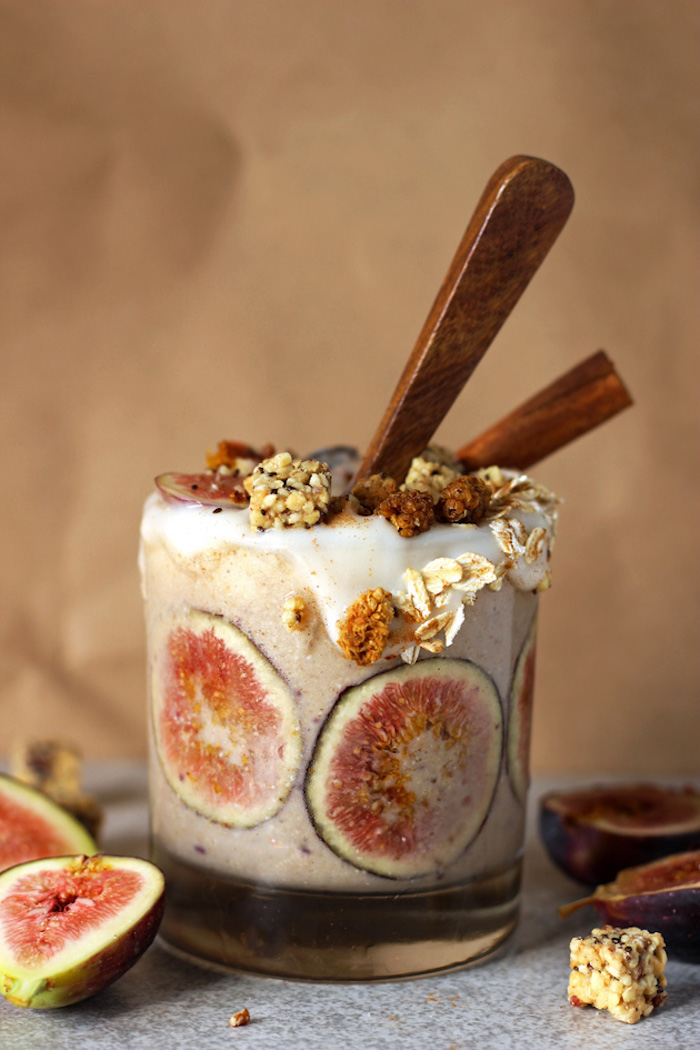 fig slices in clear tumbler, filled with beige creamy liquid, and decorated with crunchy toppings, protein shake recipes