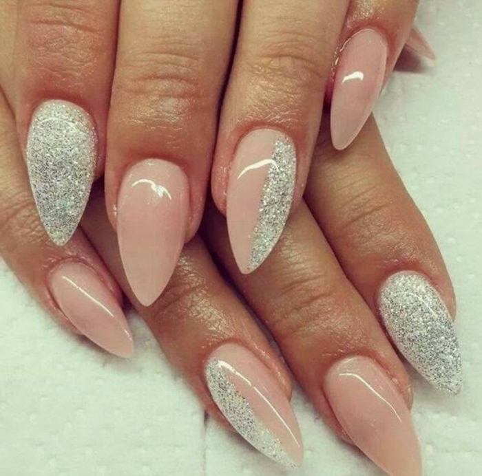 fine silver glitter, on long and pointy nails, covered in pale pastel pink nail polish, sweet and effective look