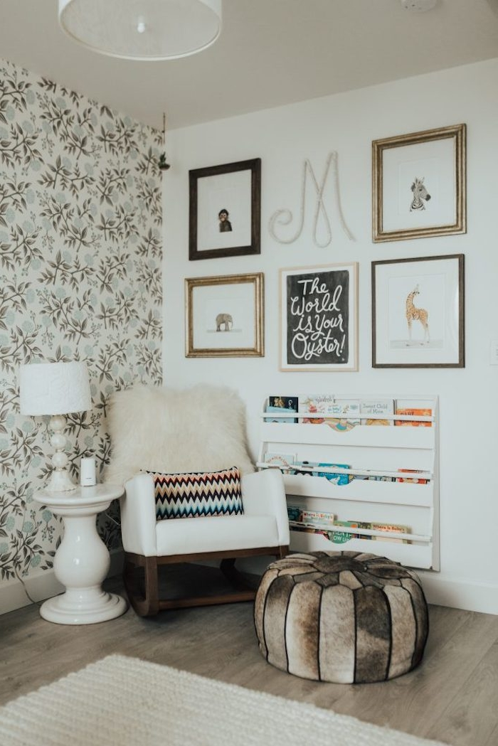 drawings of different animals, and an inspirational poster, near shelves with children's books, and white rocking chair, baby girl nursery ideas, neutral natural colors