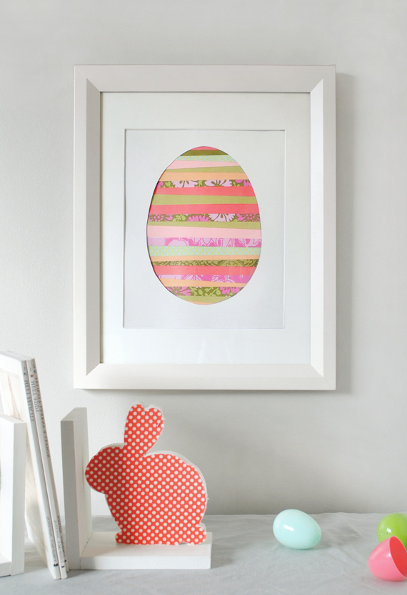 paper art in white frame, easter crafts for adults, colorful egg-shape, made from washi tape strips, in different colors and patterns