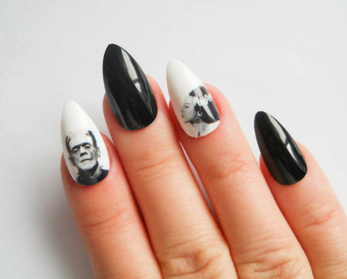 halloween manicure with black and white stickers, of frankenstein and his bride, on sharp stiletto nails, painted in shiny, white and black nail polish