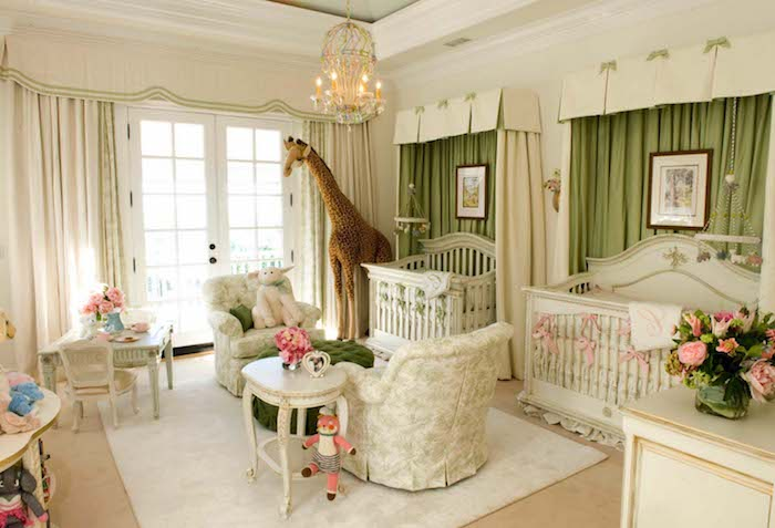 twin boy and girl, baby nursery ideas, white cribs decorated with pink and green ribbons, two white tables and armchairs, green curtains and large stuffed giraffe toy