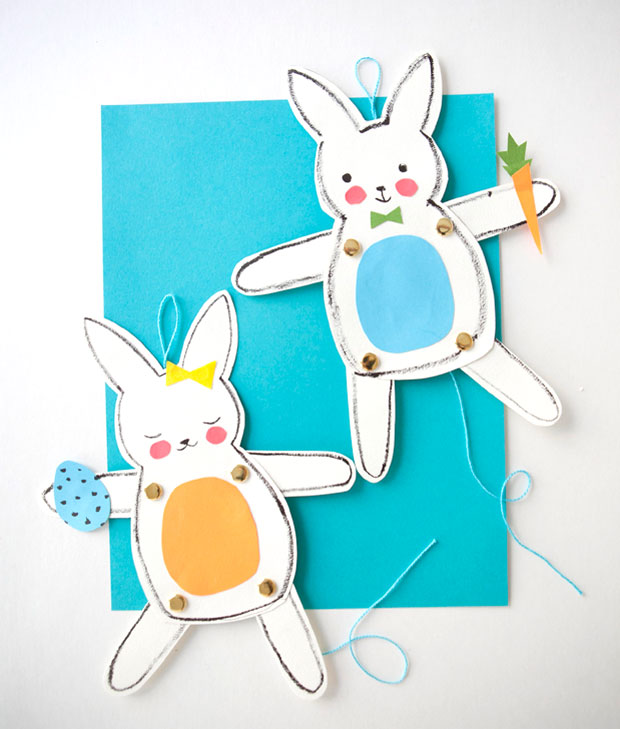 male and female easter bunny paper dolls, with movable legs and arms, decorated with colorful paper cutouts