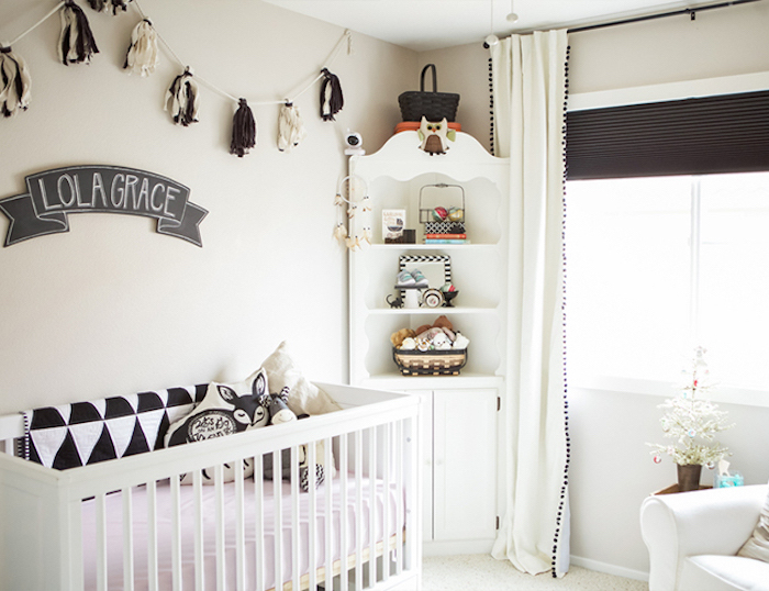 contrasting baby girl room décor, white and dark gray theme, white crib and cupboard, dark gray banner with baby's name
