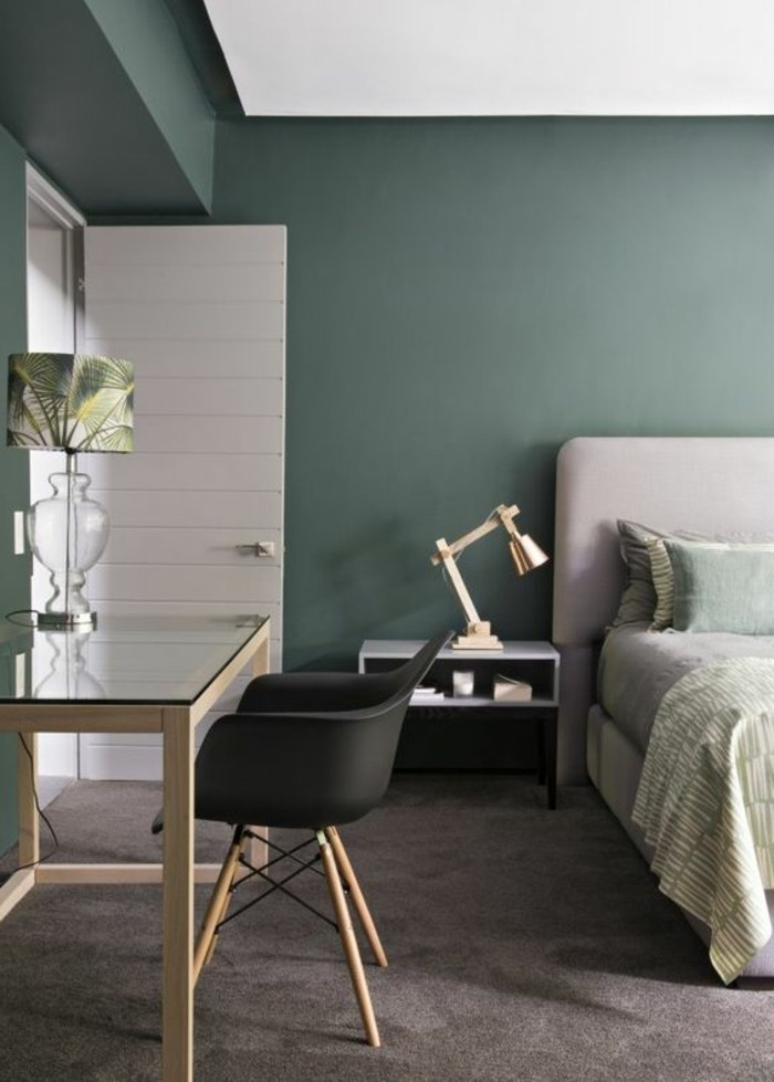 mink-colored carpet, and grey bed, with light green and grey bedding, inside room with green, blue grey paint on walls
