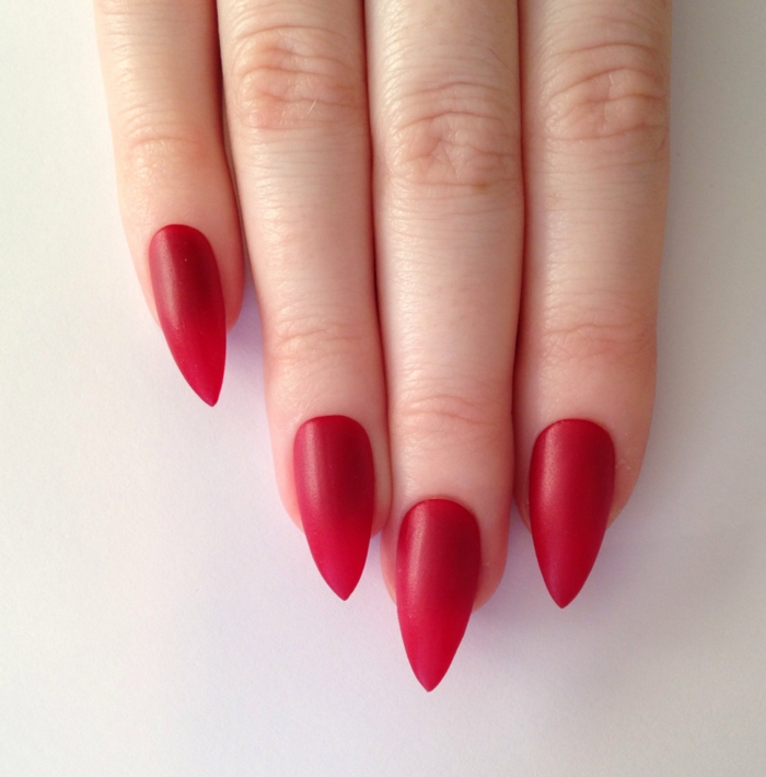 celebrity style manicure, long and sharp nails, painted in matte red nail polish, simple and classy