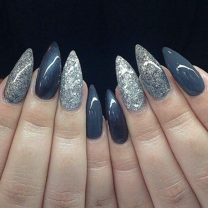 dark bluish-grey manicure, with silver and white glitter, and lead-colored nail polish, on long stiletto nails