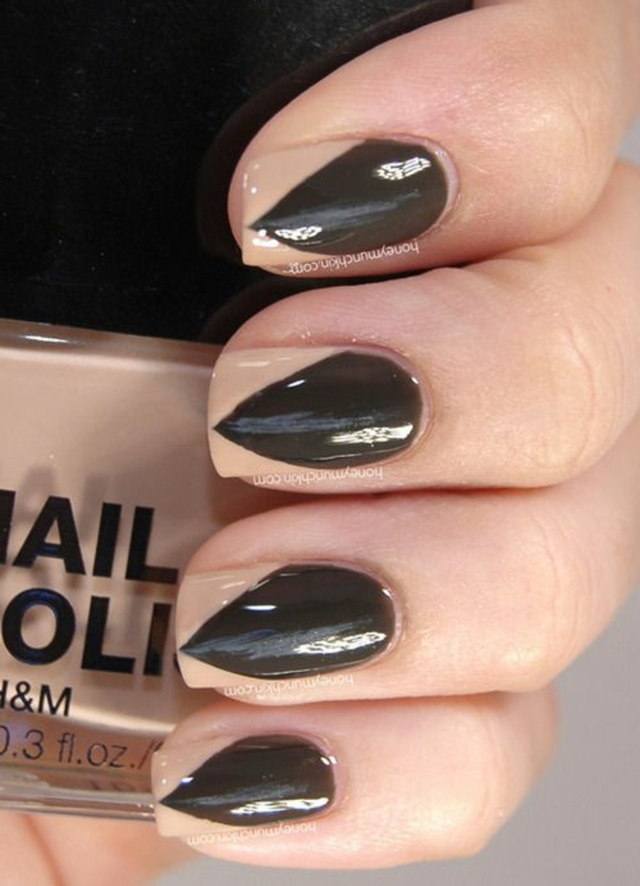 faux sharp black stiletto nails, created through optical illusion, made with nude beige, and black nail polish