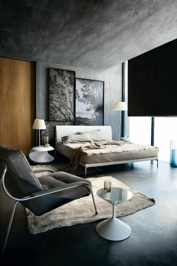 modern or industrial bedroom, with blue grey paint on walls, contrasting light wooden door, pale beige rug, accent color with gray walls