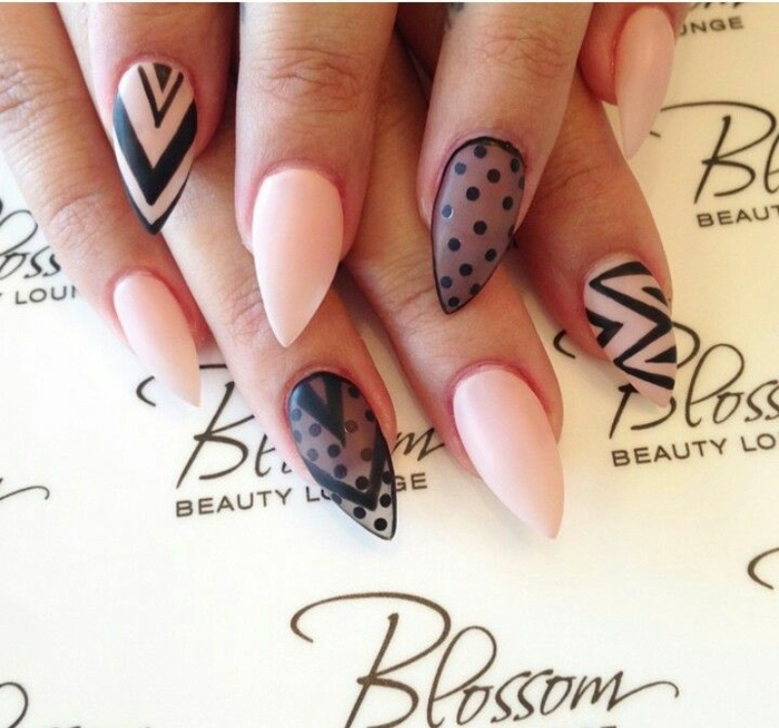 sheer black nail polish, decorated with opaque, black polka dots, on sharp manicure, in pale pink