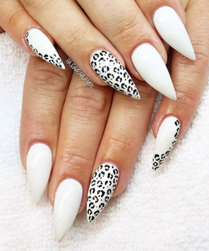 animal printed nails, in white and black, small leopard spots, on sharp and long stiletto nails