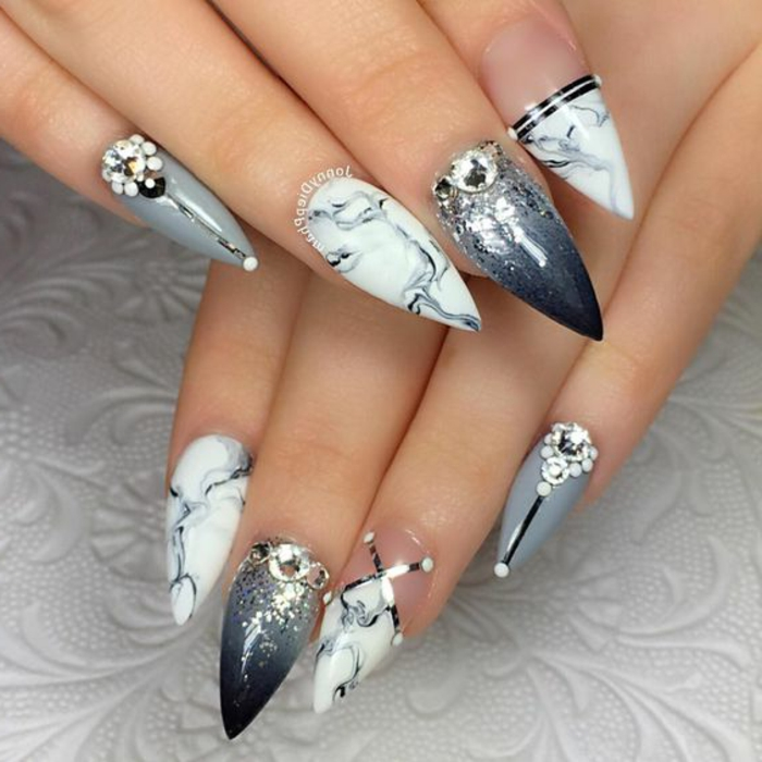 gray nail-polish in differemt combinations, marble effect and ombre, decorated with glitter, rhinestone and metallic stickers, on sharp stiletto nails