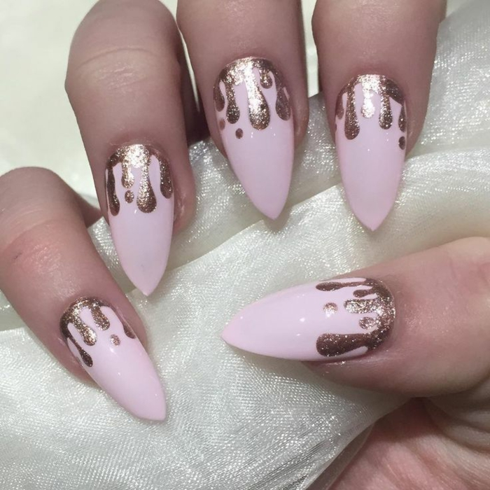 baby pink nail polish, with melting effect, made with rose gold glitter, on sharp oval manicure
